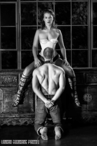 Dominatrix Viktoria Sway and Kneeling submissive